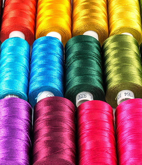 cones of industrial sewing threads in a wide range of colors